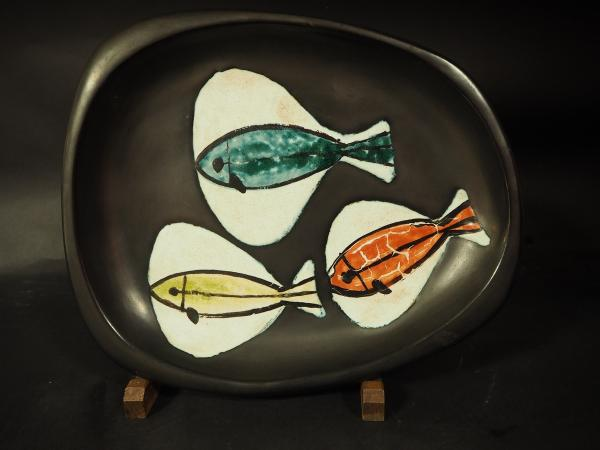 Georges JOUVE (1910-1964).  - Coupe creuse de forme libre en faïence sur talon,[...]