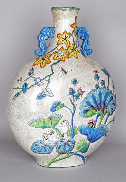 LONGWY, XIXe siècle  - GOURDE en faïence émaillée figurant oiseaux, insectes et [...]
