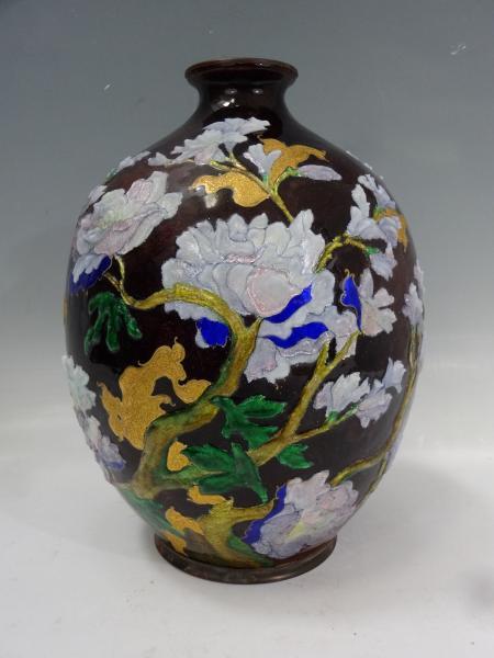 Camille FAURE (1874-1956) Vase ovoïde à col ourlé en cuivre à décor tournant de[...]